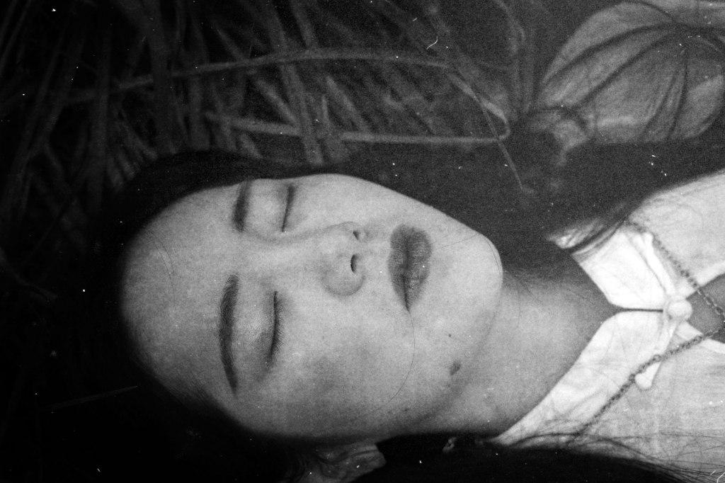 girl-portrait-on-grass-dark-monochrome