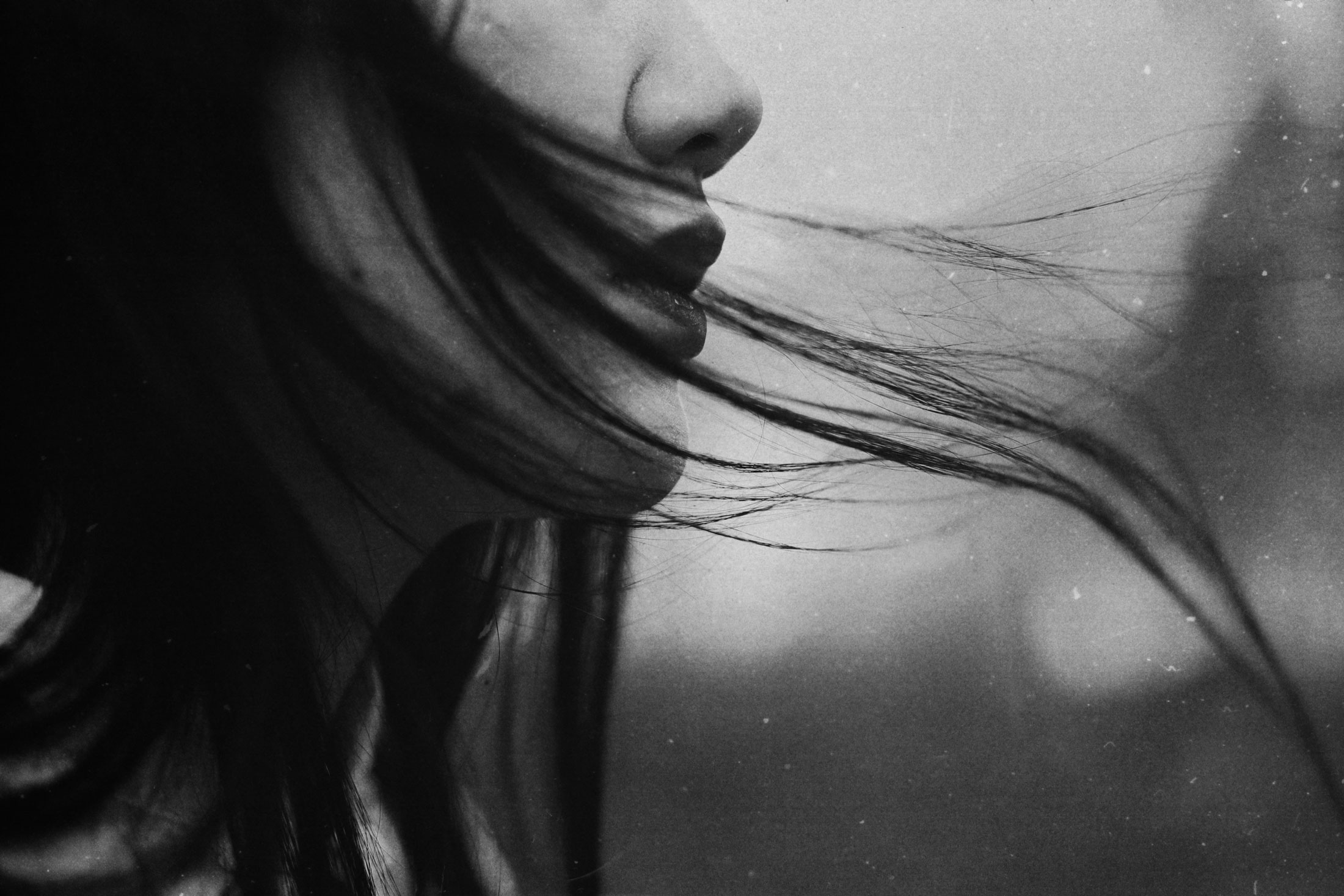 hair-in-the-wind-monochrome-uncanny-portrait