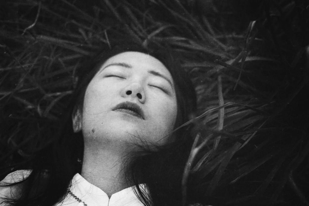 uncanny-girl-monochrome-portrait-on-grass-faded